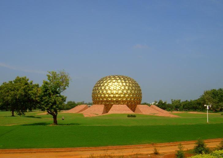 auroville_south_india_tourism_travel_matrimandir_gold_circle_temple_facade_pondicherry_grass_landscaping_spiritual_meditation