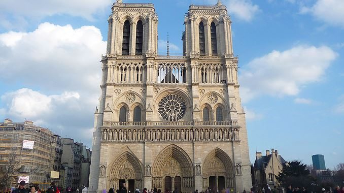 building_notre_dame_cathedral_paris_france_europe_tour_travel_tourism_vacation_trip_day_intricate_carving_church_arch_exterior