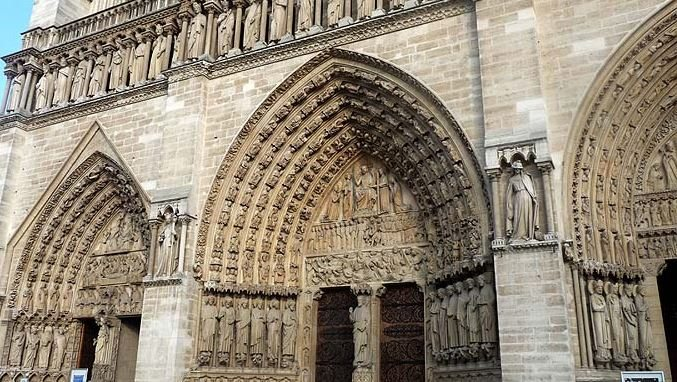notre_dame_cathedral_paris_france_europe_tour_travel_tourism_vacation_trip_day_intricate_carving_church_arch_exterior