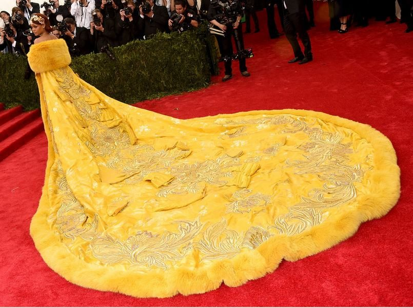 2015_met_gala_gown_dress_outfit_rihanna_yellow_bright_long_trail_fur_big