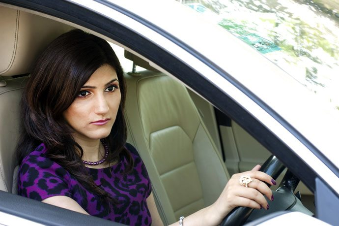 shilpa_ahuja_car_work_wear_power_dressing_purple_dress_fierce_woman_professional_pearls_office_black_heels_driving