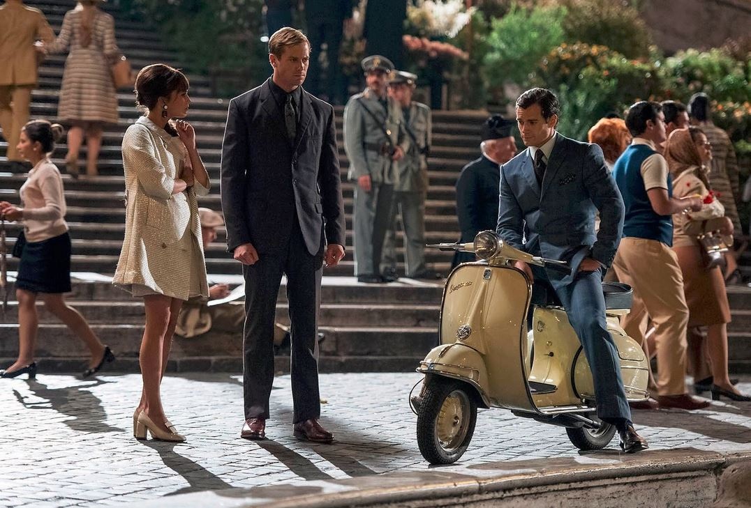 the_man_from_uncle_gaby_white_dress_jacket_earrings_shoes_vespa_night_scene