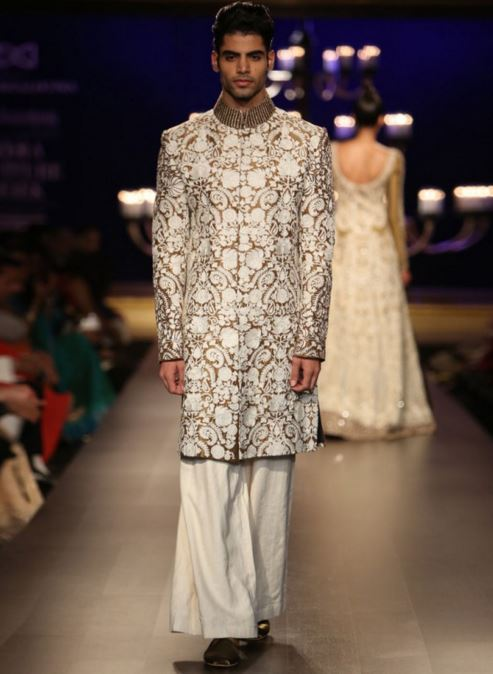 designer-wedding-sherwani-for-men-latest-trends-fall-winter-2015-2016-groom-outfit-manish-malhotra-paisley-design-gold-brown-broad-pants