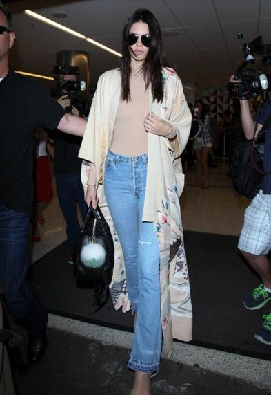 Kendall-Jenner-street-style-nude-top-blue-ripped-jeans-white-shawl