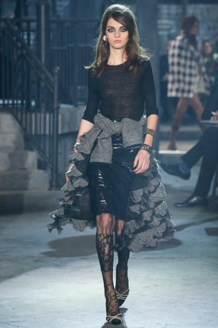 chanel-pre-fall-2016-fashion-show-look-black-kinky-top-leather-skirt-jacket-laced-stockings