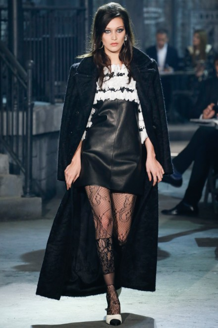 chanel-pre-fall-2016-fashion-show-look-quilted-dress-black-cape-laced-stockings