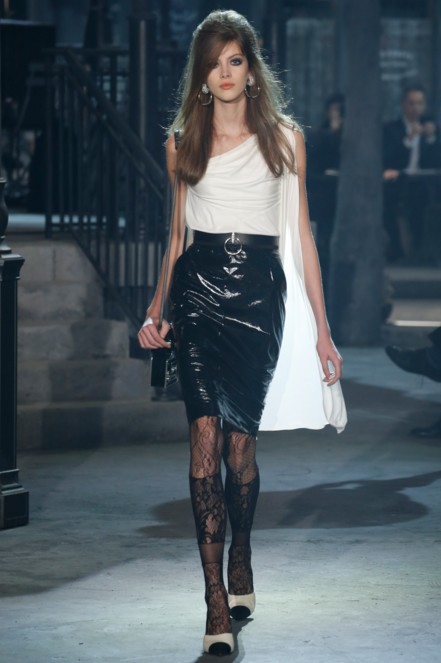 chanel-pre-fall-2016-fashion-show-look-white-one-sleeved-top-black-leather-skirt-laced-stockings