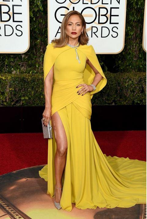 jennifer-lopez-giambattista-valli-yellow-trail-gown-golden-globe-awards-2016-celebrity-red-carpet-dresses