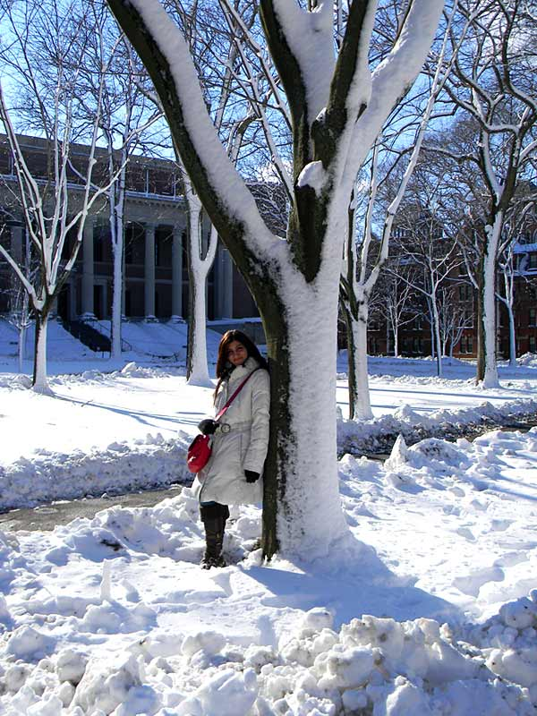 shilpa-ahuja-harvard-fashion-blogger-snow-white-coat-winter-jacket-outfit-boots-red-bag