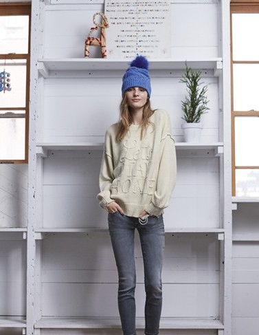 winter-accessories-latest-trends-women-hats-caps-wool-blue-knit-pompom