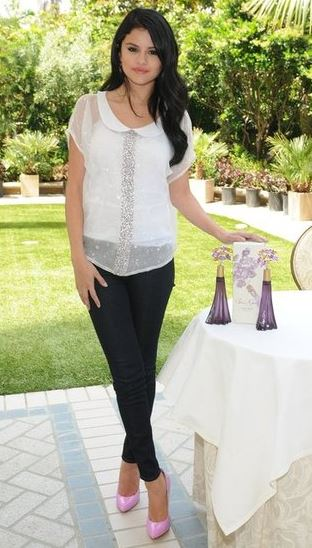 selena-gomez-best-summer-street-style-white-sheer-top-black-leather-pants-celebrity-casual-outfit-pink-shoes