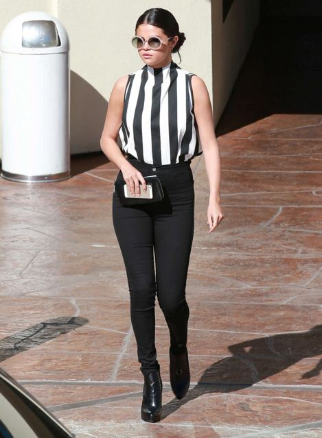 selena-gomez-street-style-stiped-top-tight-pants-round-sunglasses-black-boots