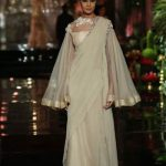 latest-saree-trends-manish-malhotra-dramatic-drape-without-pleats-cream-color-spring-2017
