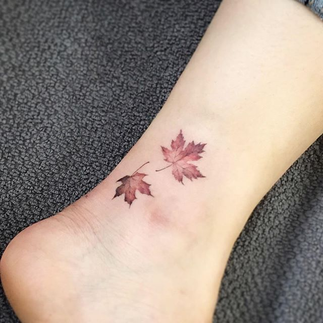 beautiful-tatoo-designs-leaves-inked-tatoo-side-leg-fall-winter-2017