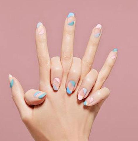negative-space-nail-art-trend-latest-ideas-2018-sally-hansen-nude-blue-white