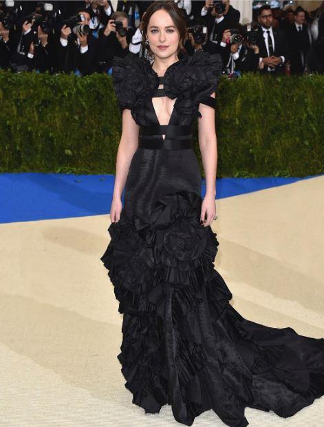met-gala-2017-celeb-style-dresses-Dakota-Johnson-layered-ruffled-black-gown