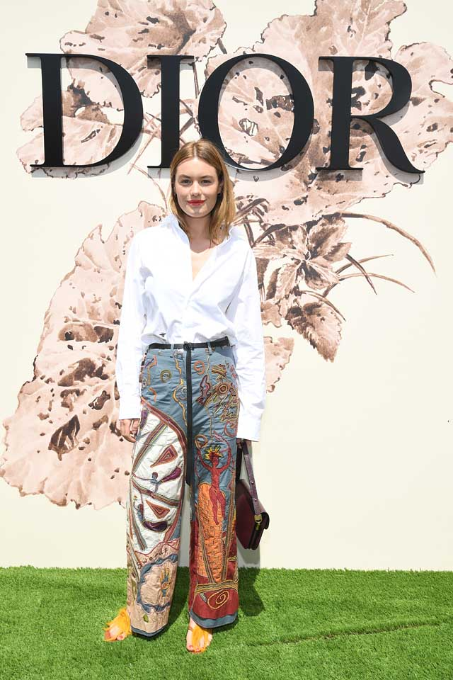 dior celeb style Camille-Rowe-white-shirt-embridered-pants-dior-haute-couture-2017-18.jpg
