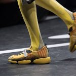 Prada-spring-summer-2018-ss18-details-backstage-4-yellow-sneakers-long-socks