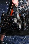 printed-black-duffle-bag-latest-handbag-trends-coach