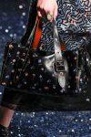 printed-black-duffle-bag-latest-handbag-trends-coach