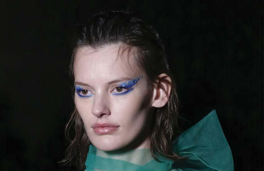 prada-fall-winter-2018-creative-makeup-looks-runway-beauty-hair-crystals-eyeshadow