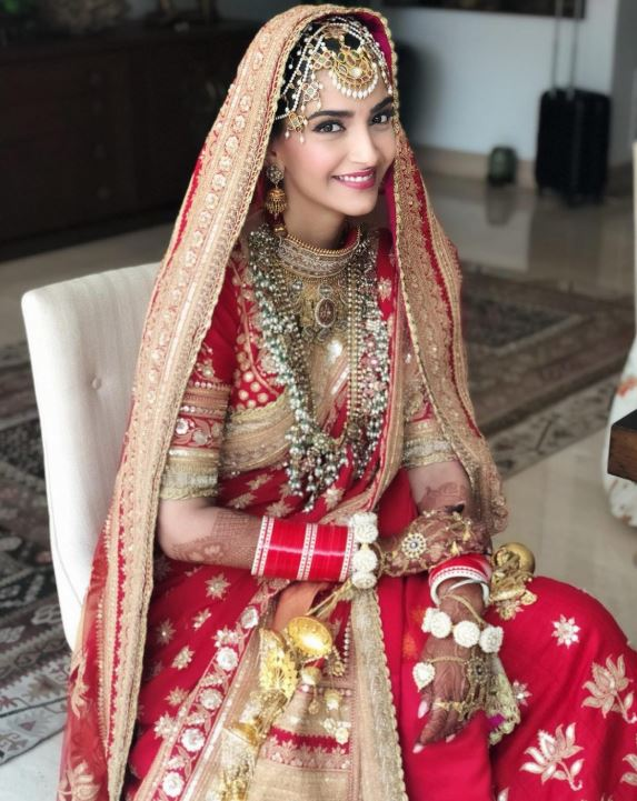 sonam kapoor ahuja wedding pics bridal lehenga look dress