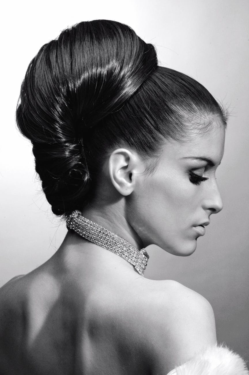 latest-hair-designs-trends-creaticve-hairstyle-flower-pins-neatly-combed-high-bun