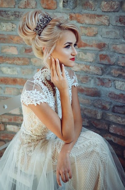 voluminous-bun-with-tiara-hairstyle-designs-trends-fashion