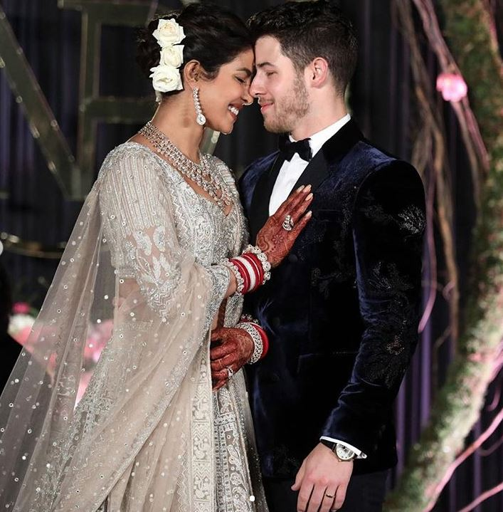 Priyanka Chopra nick Jonas wedding reception bollywood dress