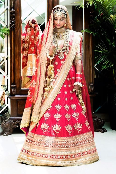 sonam kapoor ahuja red wedding pics bridal lehenga look dress