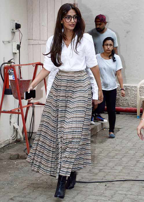 Bollywood Celeb Street Style Trends stripes sonam kapoor boots