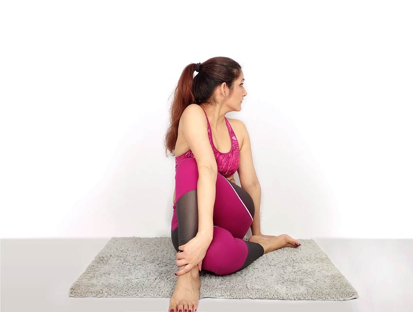 Matsyendrasana medium difficult yoga pose position